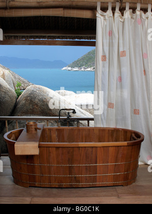 Bathroom with a wooden tub at the Evason Hideaway Resort and Spa in Nha Trang, Vietnam, Indochina, Southeast Asia, - Stock Photo