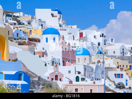 Orthodox churches and stuccoed colorful houses, Oia, Santorini, Cyclades Islands, Greek Islands, Greece, Europe - Stock Photo