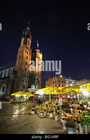St. Mary's Basilica (Kosciol Mariacki),  Gothic Church in Main Market Square (Rynek Glowny) by Night, Krakow (Cracow), - Stock Photo