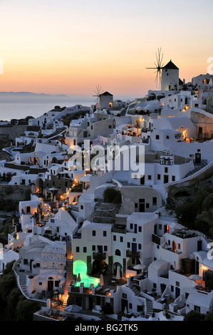 Traditional houses at Oia village just after sunset, Santorini island, Greece, - Stock Photo