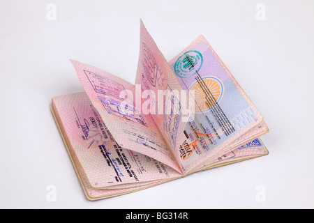 UK Passport pages with destination stamps from different countries. - Stock Photo