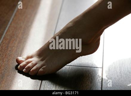 Walking barefoot . Bonn , Germany .   - Stock Photo