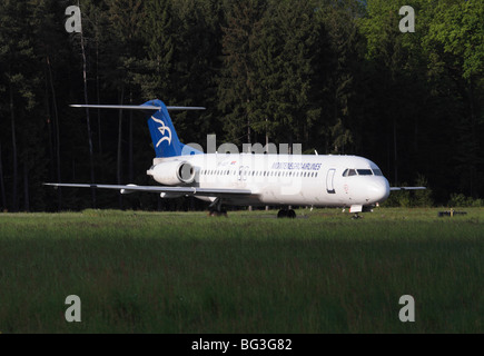Montenegro Airlines Fokker 100 about to depart from Ljubljana Airport - Stock Photo