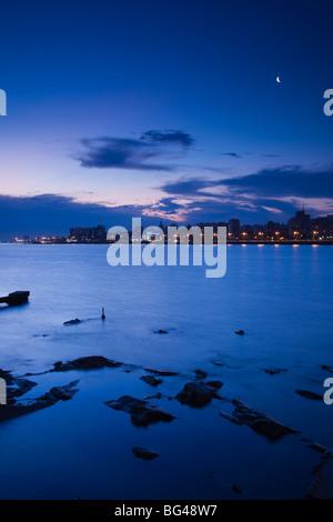 Uruguay, Montevideo, view from La Rambla, waterfront, dusk - Stock Photo