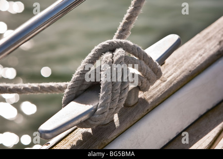 Yacht cleat with mooring rope - Stock Photo