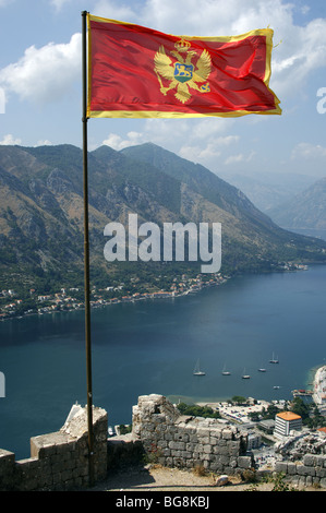 Flag of the Republic of Montenegro with the fjord at the background. Kotor - Stock Photo