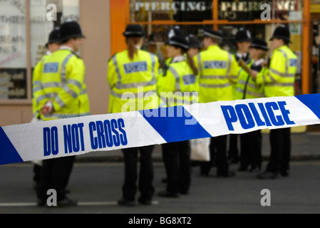 group of policemen and policewomen behind the lines - Stock Photo