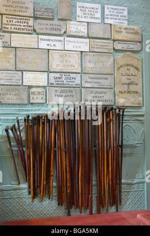 Crutches in St. Joseph's Oratory Chapel, Montreal, Canada - Stock Photo