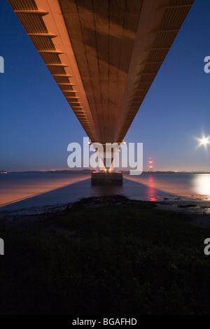 Looking directly  up at the Severn Bridge at night - Stock Photo