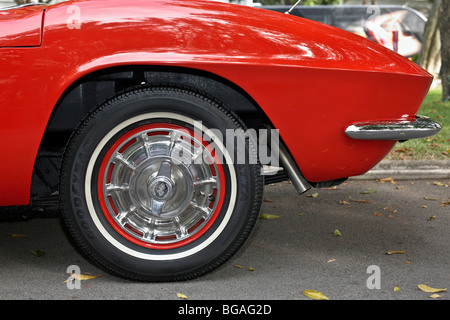 1961 Chevrolet Corvette sports car rear wheel and wing detail - Stock Photo