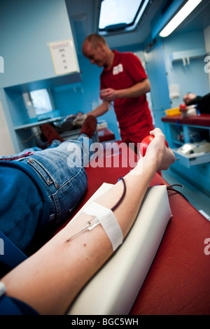 Blood donation in a Red Cross blood donation car - Stock Photo
