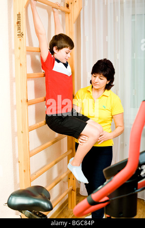 Physiotherapist and patient doing physiotherapy - Stock Photo