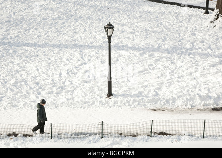 A little boy walks on a snow covered path in Central Park in New York, USA, 20 December 2009. - Stock Photo