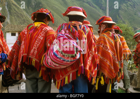Peruvian porters on the Inca trail wearing woollen ponchos scarves or shawls, wait to guide tourists along the route. - Stock Photo