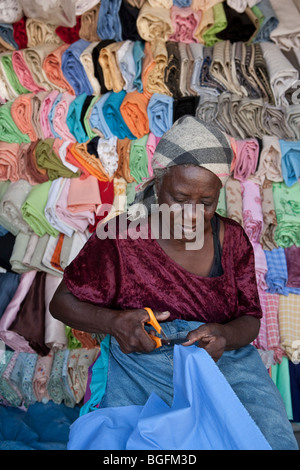 Woman in a cloth shop - Gonaives, Artibonite Department, Haiti - Stock Photo