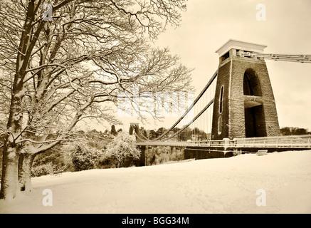 Winter snow covers the Clifton suspension bridge in Bristol - Stock Photo