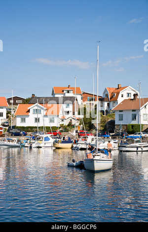 Sailboat on the way out from the port Mollosund in Sweden - Stock Photo