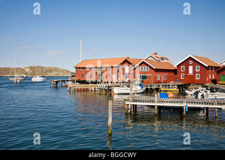 Harbour in a small fishing village with boats at Mollesund in Sweden - Stock Photo