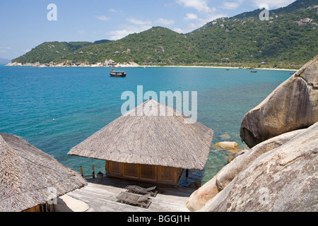 Cottages of the Evason Hideaway hotel, Nha Trang, Vietnam, high angle view - Stock Photo