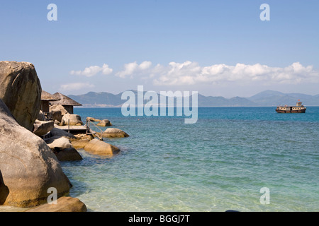 View on the cottages of a hotel at the coast, Nha Trang, Vietnam - Stock Photo