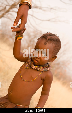 Young child of the Himba tribe, Opuwo, Namibia - Stock Photo