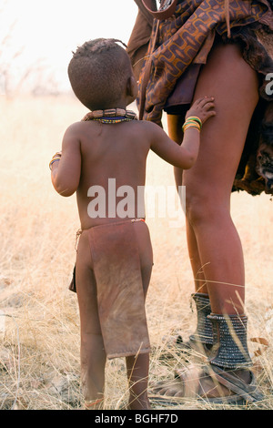 Himba child and mother, Opuwo, Namibia - Stock Photo