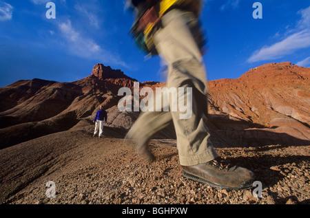Hiking in badlands near Pahreah, Grand Staircase-Escalante National Monument, Kanab, Utah,USA - Stock Photo
