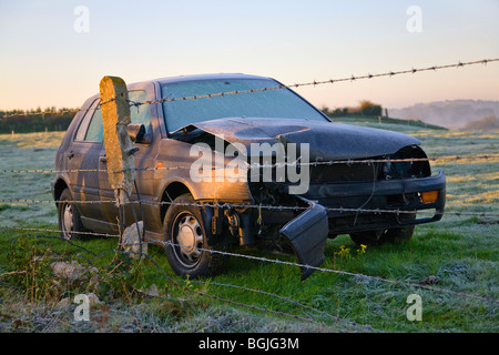 A car wreck in a field early morning, covered in frost. Borders of Dorset and Hampshire. UK - Stock Photo