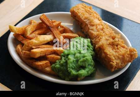 A plate of fish chips and mushy peas - Stock Photo