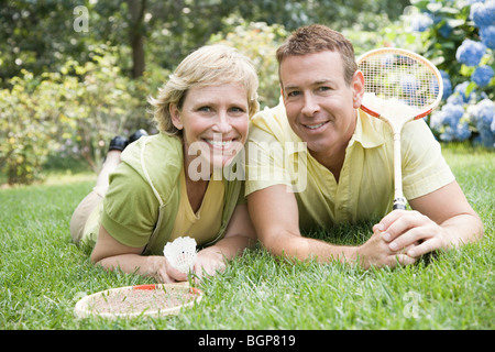 Portrait of a mature couple on grass in a lawn - Stock Photo