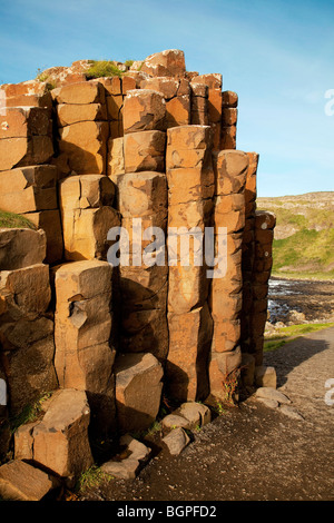 Red basaltic prisms Giant's Causeway Antrim Northern Ireland a natural phenomena and a world heritage site. - Stock Photo
