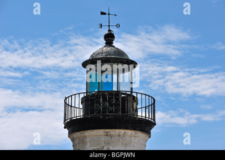 Detail of top of old abandoned lighthouse in the harbour of Guilvinec, Brittany, France - Stock Photo