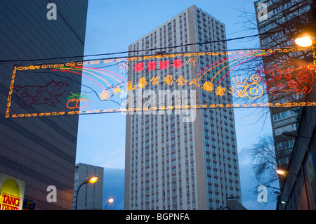 Paris, France, Street Scene, Chinatown, Apartment Buildings with neon Sign Celebrating 'CHinese New Year', Lit up - Stock Photo