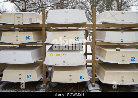 Stack of dinghies lined up in the snow - Stock Photo