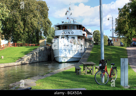 The old passenger ship M/S Juno, IMO 8634132, passing Göta Canal, Sweden. - Stock Photo
