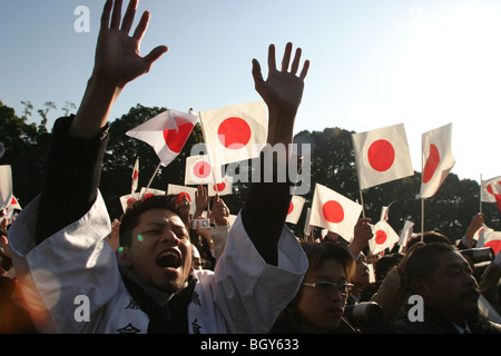 Public, including right wing nationalists, at the birthday celebrations of Japanese Emperor Akihito, Tokyo, Japan. - Stock Photo