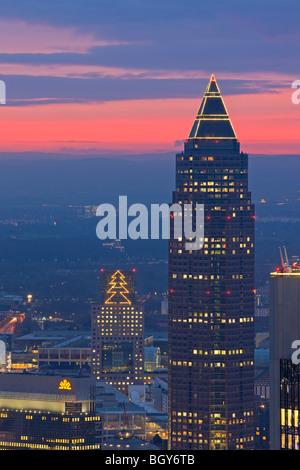 Sunset over the Messeturm skyscraper and the City of Frankfurt am Main, Hessen, Germany, Europe. - Stock Photo