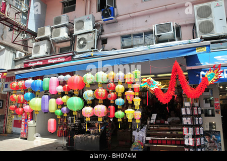 Chinese lanterns and paper dragon hanging outside a shop selling Chinese seals, Stanley Market, Hong Kong, China - Stock Photo