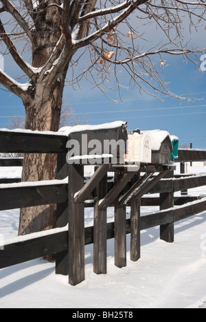 Rural delivery mailboxes in winter snow and ice after a storm. - Stock Photo