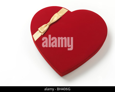 Red heart-shaped gift box isolated on white background - Stock Photo