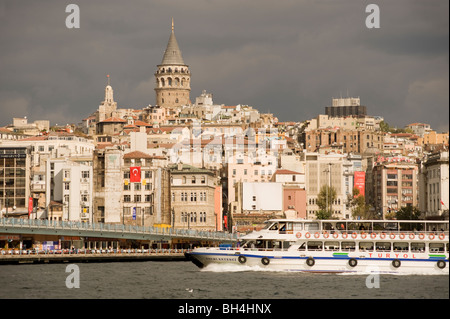 The North Bank of the Golden Horn, The Galata Tower, Tourist Boat, Istanbul, Turkey - Stock Photo