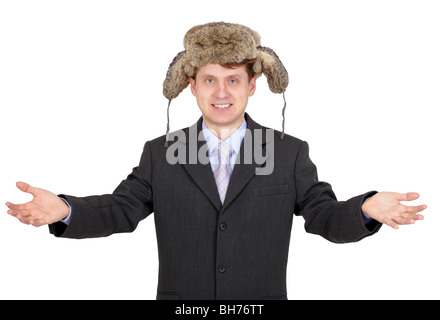 Hospitable funny man with a fur hat on white - Stock Photo