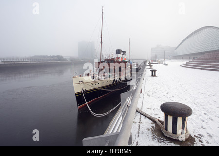 The Waverley Paddle Steamer berthed at a snowy Pacific Quay on the River Clyde in Glasgow, Scotland, UK - Stock Photo