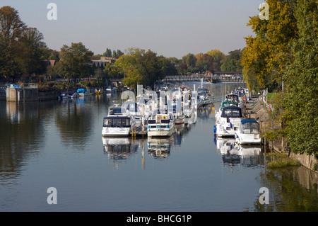 Moored boats and lock on the River Thames at Hampton Court, Surrey, England on an autumn day - Stock Photo