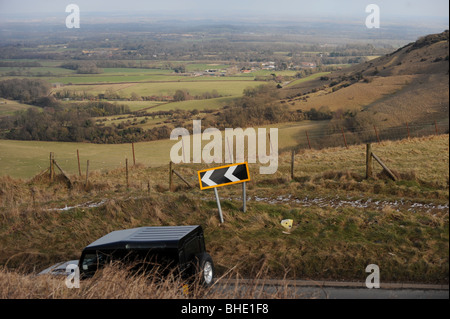 A four wheel drive vehicle heads down Ditchling Beacon part of the South Downs Way in Sussex UK - Stock Photo