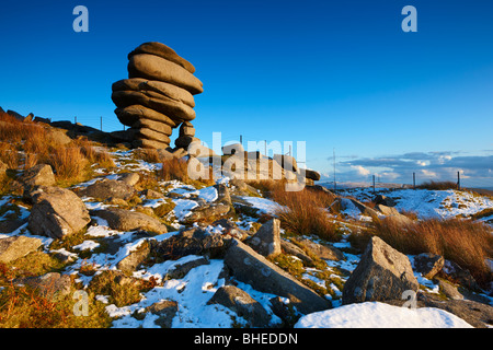The rock formation know as the Cheesewrings stands high up on Bodmin Moor after snowfall - Stock Photo