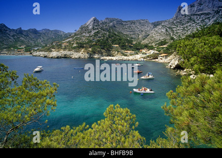 Boats in a small bay under blue sky, Calanque de Sormiou, Cote d´Azur, Provence, France, Europe - Stock Photo