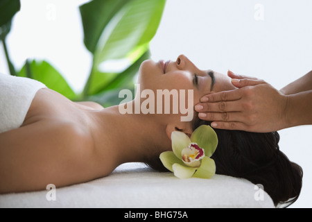 Woman having a head massage - Stock Photo