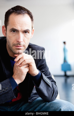 man in front with woman in background - Stock Photo