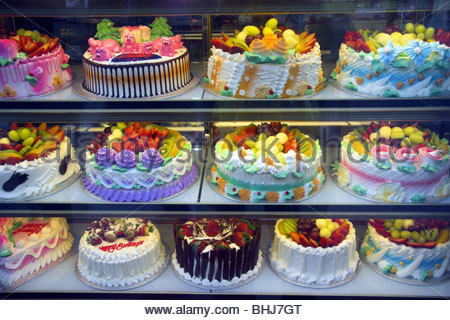 Shop window display of nice cakes in London's Chinatown district in Soho. London, UK. - Stock Photo